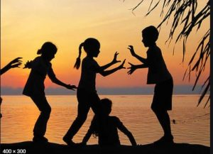 Children in a Group Outside at Sunset