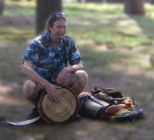 Merlin teaching drumming